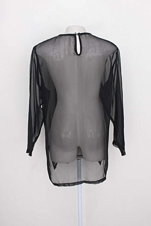 Blusa feminina preto com Transparência_foto de costas